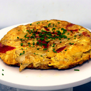 Potato Tortilla with Artichokes and Red Peppers.