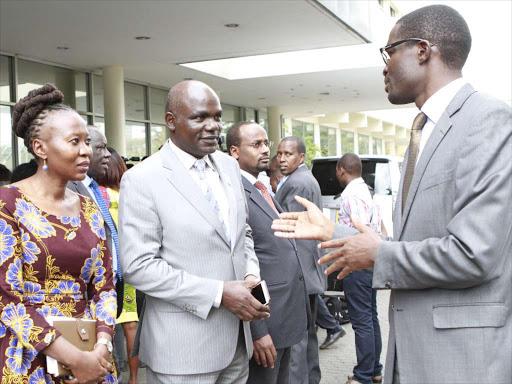 Former IEBC commissioner Roselyne Akombe, chairman Wafula Chebukati and ex-CEO Ezra Chiloba in a file photo.