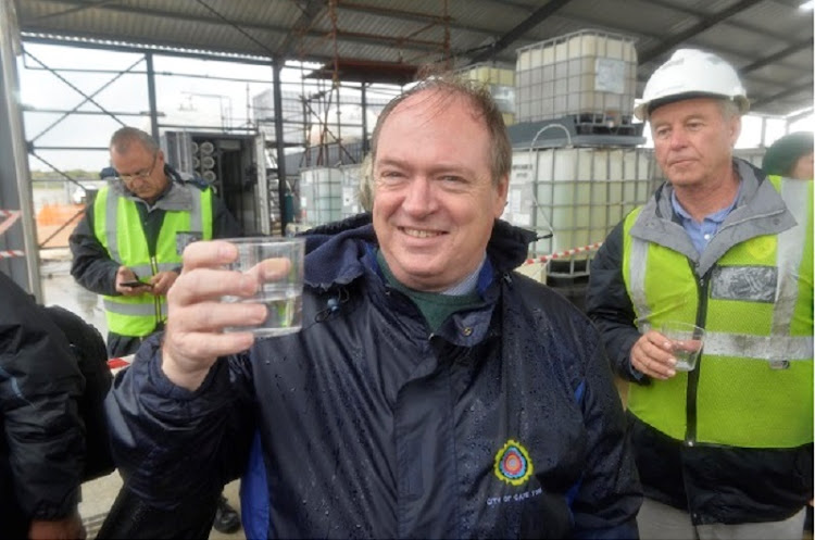 Cape Town deputy Mayor Ian Neilson tests the water during a site visit to Cape Town's first desalination plant. Picture: SUPPLIED