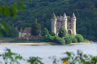 Photo: Chateau de Val, Cantal. This was a hilltop castle before the waters of a reservoir advanced nearly to its gates.