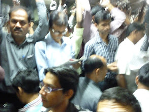 Photo: Ajit Bobhate in the foreground, fortunately sitting on the train during the 2.5 hour journey to Asangaon on a fast local train.