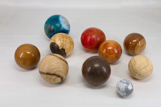 """Photo: Clif Poodry 3"""" - 5"""" spheres [maple, walnut, oak, acrylic, osage orange]"""