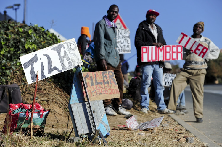 Unemployed people wait for work outside Builders Warehouse in Johannesburg. Picture: GALLO IMAGES/HERMAN VERWEY
