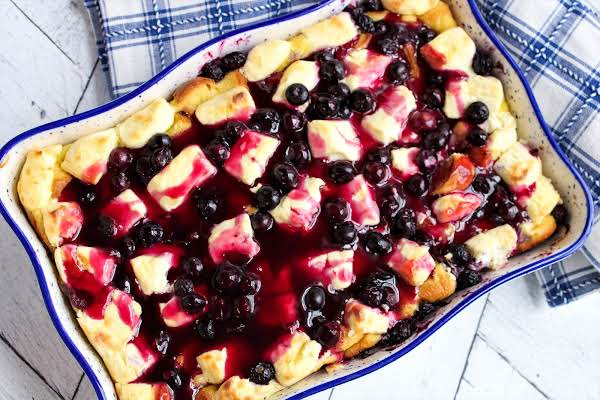 Blueberry Sauce Poured Over The French Toast Casserole.