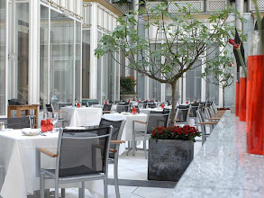 Photo: Enjoy a meal al fresco overlooking the hotel courtyard on the magnificent Terrasse Rouge.