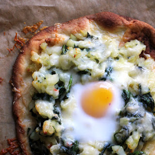 Breakfast Pizza with Hash Browns, Spinach, and Eggs.