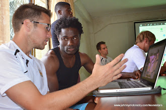 Photo: Goalkeeping coach Andrew Sparks provides keeper Solomon Zombo Morris with pre-game video analysis [Leone Stars Vs. Equatorial Guinea, 7 Sept 2013 (Pic: Darren McKinstry)]