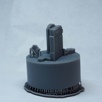 3d printing gallery image of a small snowglobe insert in sla resin made on a formlabs machine, designed to match the architecture of palms casino