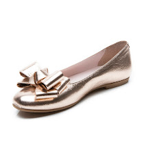 2ea385c25ef5 These metallic slip on pumps from Step2wo are available in gold and rose  gold leather and feature a large matching decorative layered bow on the toe.