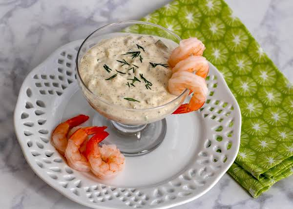Dill Tartar Sauce In A Serving Dish With Shrimp.