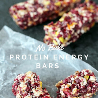 Flavorful No Bake Protein Energy Bars Are Made With Simple Ingredients Including  dates, Dried Cranberries, Pistachios , Orange Zest And Whey Protein.