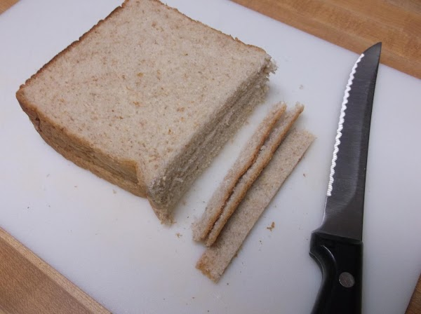 On a clean, flat surface (such as cutting board), using a serrated knife, cut...