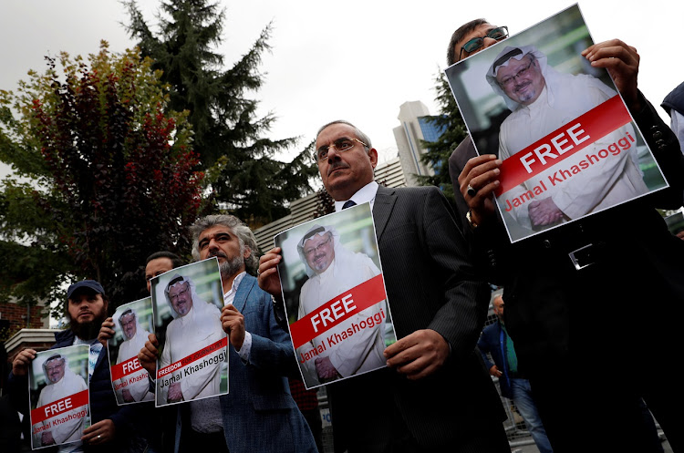 Human rights activists and friends of Saudi journalist Jamal Khashoggi protest outside the Saudi Consulate in Istanbul.