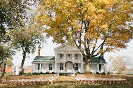 small wedding venue house with chairs ready for a wedding ceremony