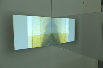"""Photo: Projection of """"Ground Before Wind,"""" 2012, sd single channel video, on wood and mirrored plexi-glas object, 4'x4'x26"""", UofC DoVA MFA critique, spring quarter 2012. mgf"""