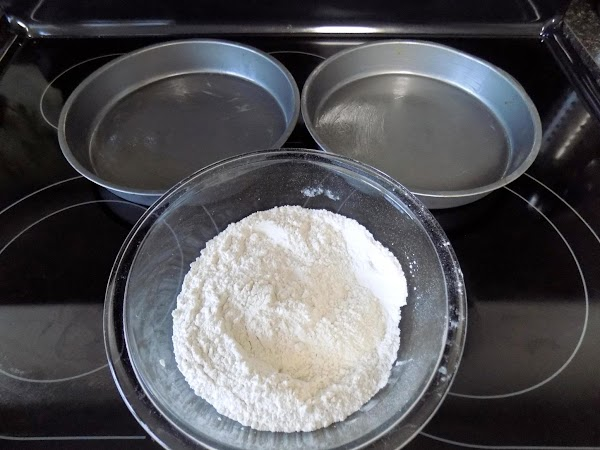 Using cooking spray, coat two 8 or 9 inch round cake pans.  In...
