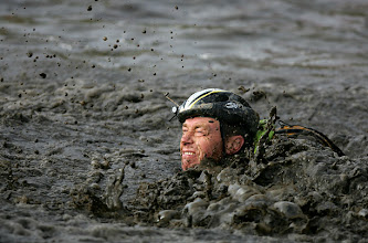 Photo: WOLVERHAMPTON, UNITED KINGDOM - JANUARY 27:  A competitor in action during the Tough Guy Challenge 2008 at South Perton Farm on January 27, 2008 near Wolverhampton, England.  (Photo by Paul Gilham/Getty Images)