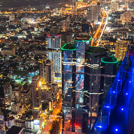 Bangkok Thailand : December 30, 2018  Beautiful Bangkok in the night by Waraphorn Aphai - Buildings & Architecture Office Buildings & Hotels ( vehicles, long exposure, skyline, aerial, scenery, twilight, building, speed, symphony, beautiful, central, modern, thailand, cityscape, dynamic, landmark, illuminate, architecture, tower, traffic, famous, business, metropolitan, motion, reflection, asia, night, asian, bangkok, downtown, skyscraper, way, transportation, glowing, urban, light, travel, movement, landscape,  )