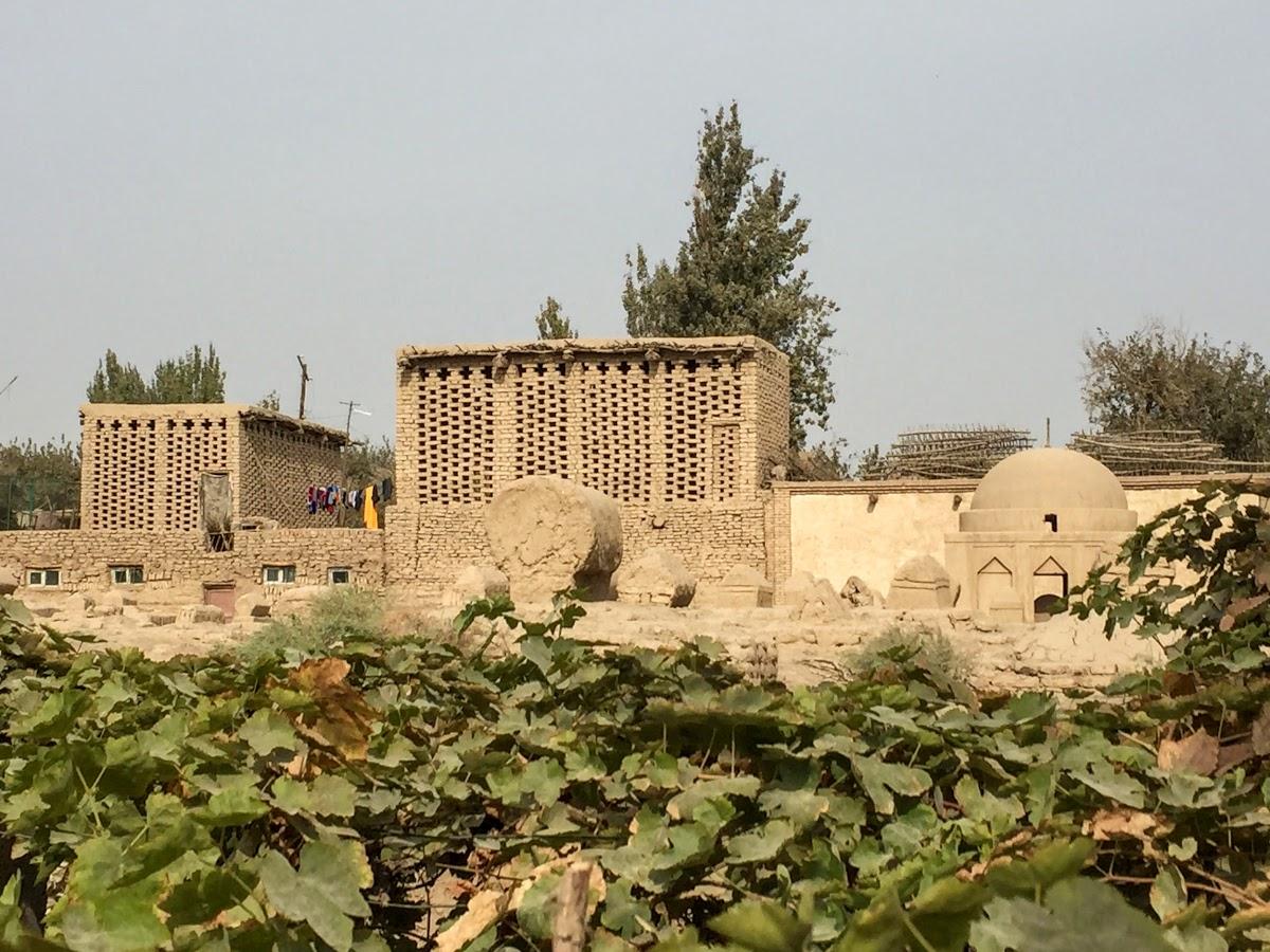 China. Xinjiang Turpan . Vineyard, Cemetery and Chunce in Turpan