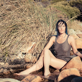 River by Riaan Swanepoel - People Portraits of Women ( grass, sunset, rocks, river )