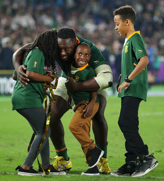 Tendai Mtawarira embraces his children after victory in the Rugby World Cup final between England and South Africa at International Stadium Yokohama on November 2 2019 in Yokohama, Kanagawa, Japan.