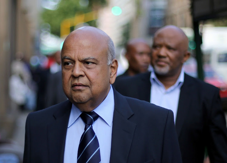 Former finance minister Pravin Gordhan walks with his deputy, Mcebisi Jonas, in Pretoria. Picture: REUTERS