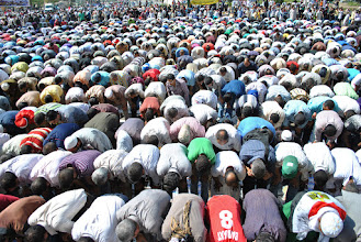 Photo: Another view of the mass prayer in Tahrir Square.