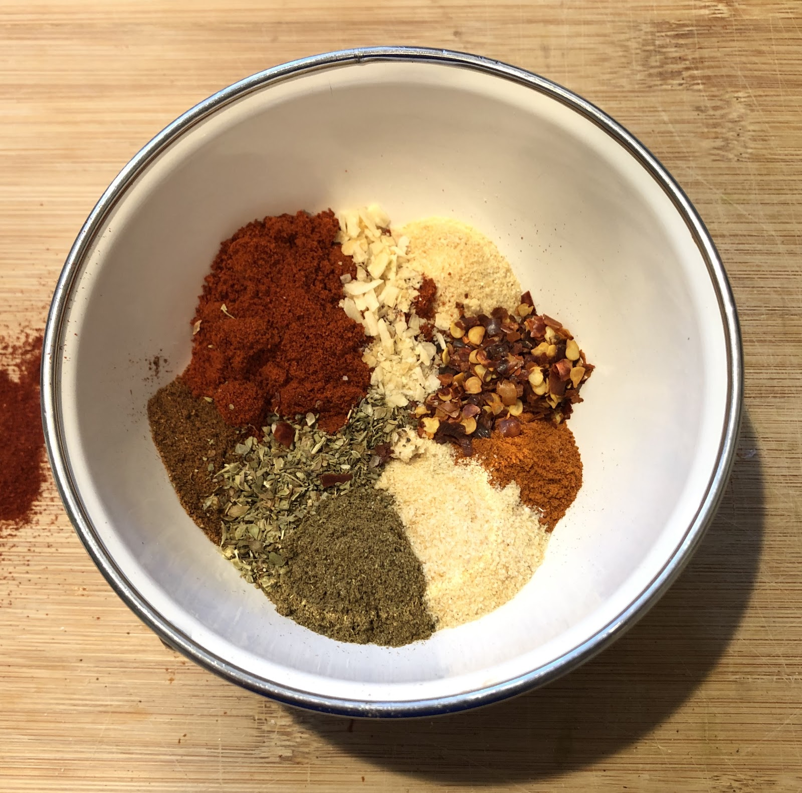 dried herbs and spices for chili seasoning in a bowl