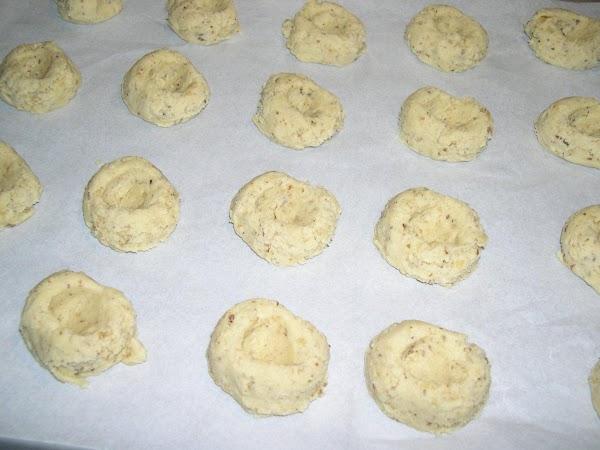 Thumb print the cookies and bake