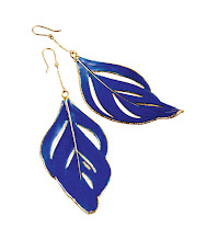 Photo: AURELIE BIEDERMANN Swan feather earrings dipped in yellow gold and coated with blue enamel. $1,265. Main Floor. 212 872 8775