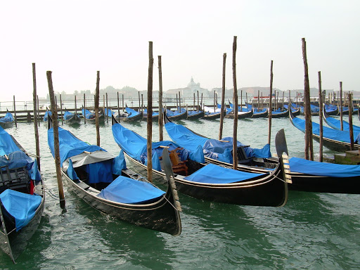 gondolas-in-venice2.jpg - Gondolas at rest in Venice.