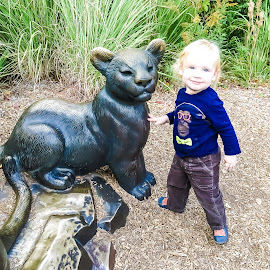 Fe at the Zoo by Jennifer  Loper  - Babies & Children Children Candids ( grass, chimpanzee, lion cub, sculpture, zoo, blond, boy )