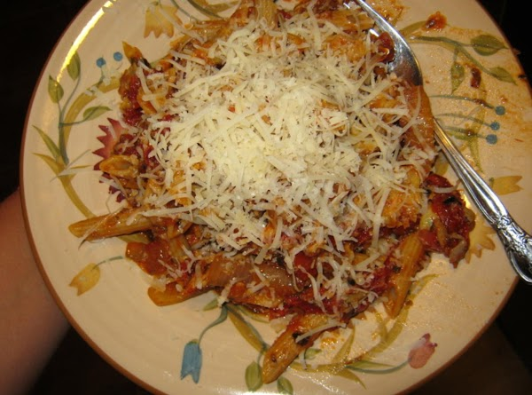 serving on a smaller plate with shredded parmesan cheese