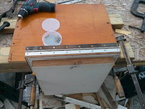 Photo: Once I achieved a snug fit with the two lids.  I installed a new piano hinge on the port (larger lid).
