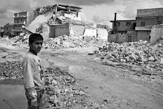 Photo: A young boy stands by the remains of a recent scud missile attack in the neighbourhood of Tariq al Bab in Aleppo, Syria. Many homes in the area have been completely destroyed by government shelling. Aleppo, SYRIA - 11/4/ 2013. Credit: Ali Mustafa/SIPA Press