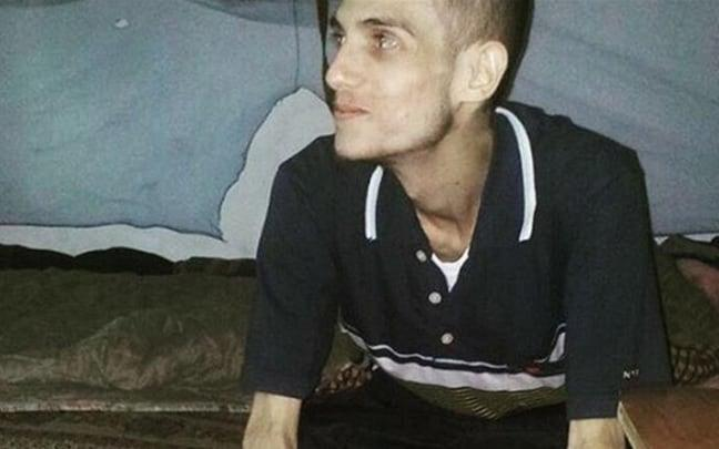 Omar al-Shogre, aged around 19 years old, after his released from Saydnaya, weighing just 5.5 stone