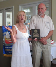 "Photo: Patti Stephens presents Tom Burbank with the ""Service Above Award Spirit of Rotary Award."" This is an award presented to a non-Rotarian for his service to the community."