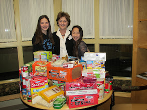 Photo: Kylee, Mary Ann & Kira with food donations from the Highlands.