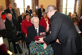 Photo: Presentation of the Ushakov Medal to Flotilla member Lt Cdr Jim Perrin RD RNR by Russian Embassy Counsellor Sergey Nalobin at a ceremony in County Hall, Exeter, on 19 December 2014, in recognition of his World War 2 service in Arctic Convoys.