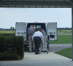 Photo: putting Stanley's casket in the van to take him to the burial plot