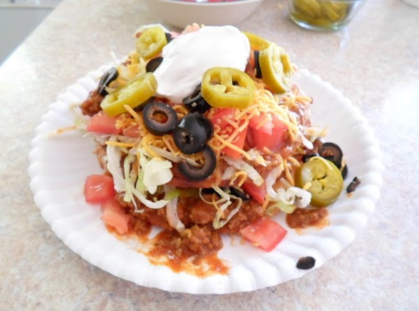 To prepare Double Decker El Pato, place one tortilla on plate, (I use paper...