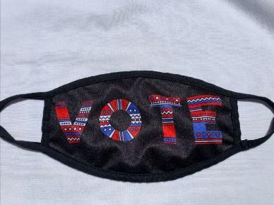 Black face mask with the word VOTE in red white and blue