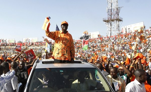 POPULAR: Coalition for Reform and Democracy presidential candidate and Kenya's Prime Minister Raila  Odinga waves to supporters as he arrives for his final campaign rally in Nairobi on Friday. Picture: REUTERS
