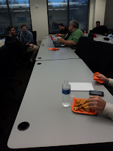 Photo: Mike Shea, Ryan Moore, Dustin Moore, & Rutledge talking before the meeting