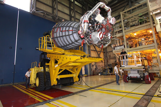 Preparations begin to install the space shuttle main engine in shuttle Discovery for the shuttle's mission to the International Space Station.