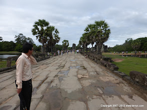 Photo: The walkway from the west gate, across the moat. Our guide in the foreground.