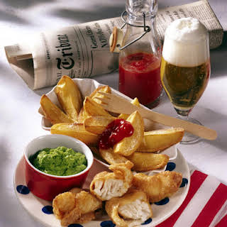 Beer Battered Fish with Potato Wedges and Mushy Peas.