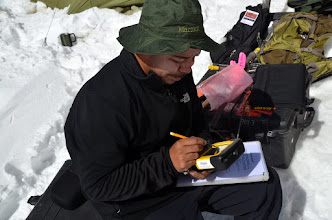 Photo: Jose calibrates the GPS in preparation for a GPR survey profile