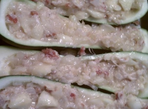 Place zucchini in pan.  Cover the bottom of each with a small amount...