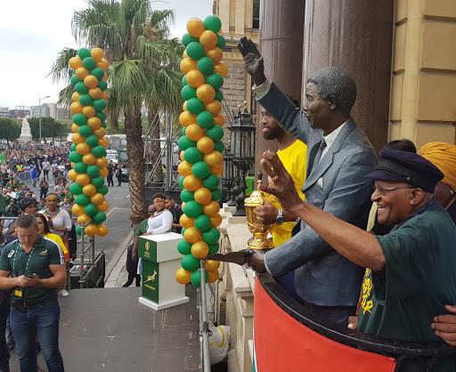 Faf keeps his clothes on, but shows Archbishop Tutu his SA flag undies